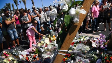 Mourners at the scene of French terror attacks in Nice.