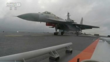 CCTV via AP Video, a J-15 fighter jet takes off from the flight deck of the aircraft carrier Liaoning during a drill in the South China Sea.