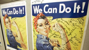 In this October 31, 2007 photo, a poster showing signatures of former Rosie the Riveter's is seen at the offices of the Rosie the Riveter/World War II Home Front National Historic Park in Richmond, Calif. A woman identified by a scholar as the inspiration for Rosie the Riveter, the iconic female World War II factory worker, has died in Washington state. The New York Times reports that Naomi Parker Fraley died Saturday, Jan. 20, 2018, in Longview. She was 96. Multiple women have been identified over the years as possible models for Rosie, but a Seton Hall University professor in 2016 focused on Fraley as the true inspiration.