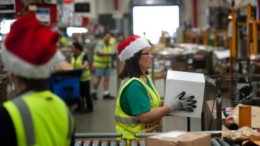 Australia Post mail depot in Sunshine as staff send out Christmas packages.