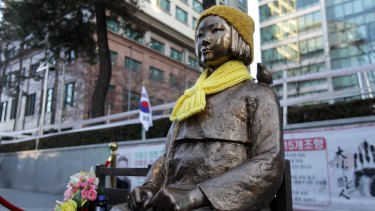 """A statue of a girl symbolising the issue of """"comfort women"""" in front of the Japanese Embassy on in Seoul, South Korea."""