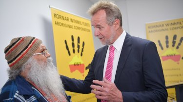 Federal Minister for Indigenous Affairs, Nigel Scullion, speaks to Local Elder Uncle Moogi at the Kornar Winmil Yunti Aboriginal Corporation in Adelaide.