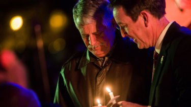 Critical of US ransom policy ... Carl Mueller holds his candle during a candlelight memorial honouring his daughter aid worker Kayla Mueller at the Prescott's Courthouse Square in Prescott, Arizona.