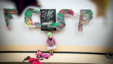Children in the kindergarten program inside the FC St. Pauli soccer team's stadium painted the team's letters.