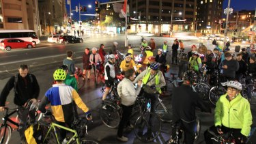 Cyclists protesting the state government's plans to rip up a cycleway on College Street.