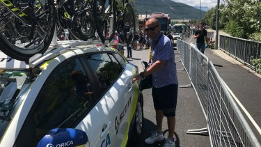 On tour: Eddie Jones gets into the Orica-Scott team car at the Tour de France.