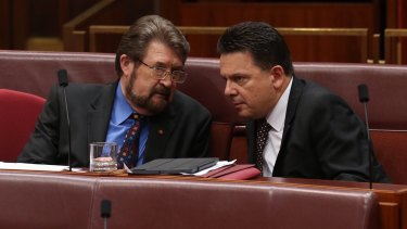 Senators Derryn Hinch and Nick Xenophon as midnight approaches in the Senate at Parliament House in Canberra on Tuesday.