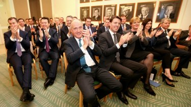Coalition MPs applaud during a meeting at Parliament House on Monday.