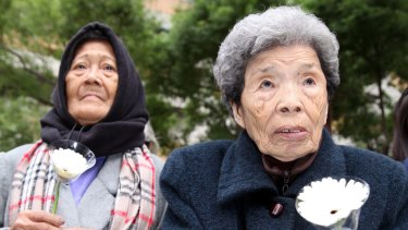 Former Philipine comfort woman, Estelita B. Dy (L), and former Taiwan comfort woman, Cheng Chen-tao, commemorating deceased comfort women outside Japan's representative office in Taipei, Taiwan.