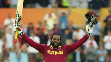 Chris Gayle of West Indies celebrates his double century during the 2015 ICC Cricket World Cup match between the West Indies and Zimbabwe at Manuka Oval