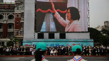 Tsai Ing-wen, Taiwan's incoming president, is seen on a screen as she is sworn in on Friday, May 20, 2016.