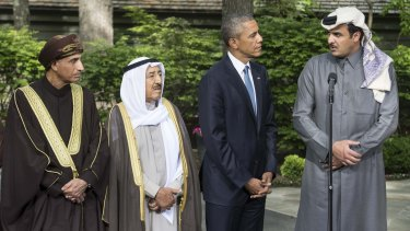 US President Barack Obama (second from right) listens to the emir of Qatar Sheikh Tamim bin Hamad al-Thani (right) at the end of a summit meeting at Camp David.