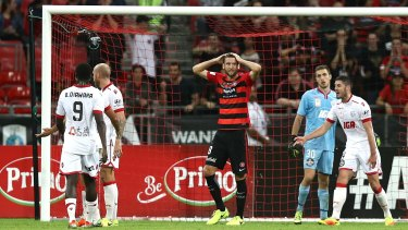 Robbie Cornthwaite of the Wanderers reacts after missing a shot on goal against Adelaide United on Saturday.
