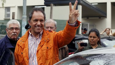 Daniel Scioli, Buenos Aires' province Governor and presidential candidate, gestures after casting his vote in a polling station in Buenos Aires on Sunday.