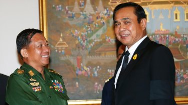 Generals: Myanmar's Min Aung Hlaing, left, shakes hands with Thai PM Prayuth Chan-ocha in Bangkok in August.