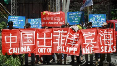 Environmental activists march in Manila in May to demand that Chinese authorities put a stop to reclamation activities in the South China Sea.