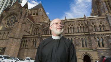 Dean of Brisbane Dr Peter Catt at St John's Anglican Cathedral. It is yet to be repaired after suffering storm damage in November 2014.