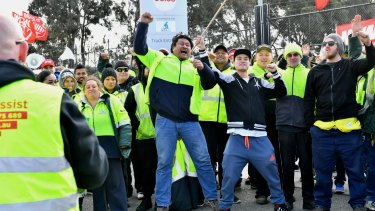 Workers picket a cold storage warehouse that supplies Coles.