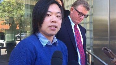 Johnathan Lau speaks outside Glebe Coroner's Court on Monday.