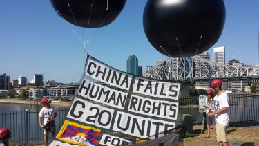 Activists from the Australian Tibet Council release two huge balloons in New Farm, Brisbane.