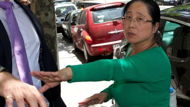 Jian Qing Xu leaves VCAT at an earlier hearing.