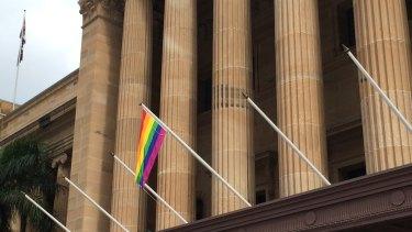 The rainbow flag flies from Brisbane's City Hall.