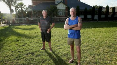 Alan Turner (right) and Paul Robinson live next to land Melbourne Water wants to sell in Rona Street, Reservoir. The land has long been used as a park.