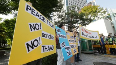 South Korean protesters stage a rally denouncing the United States and South Korean government's policy against North Korea in Seoul.