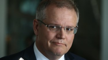 """Frontbencher Scott Morrison said he rejected Tony Abbott's offer of the Treasurer's role because it would """"throw Joe Hockey under a bus""""."""