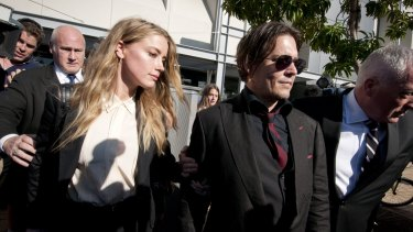 Actor Johnny Depp leaving  with court his wife Amber Heard.
