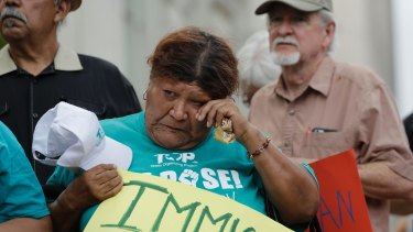 Eldia Contreras wipes away a tear as she takes part in a vigil at San Fernando Cathedral for victims who died as a result of being transported in truck on Sunday.