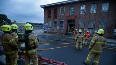 Firefighters attending an electrical fire at the Telstra exchange on Frith Street in Brunswick on Thursday.