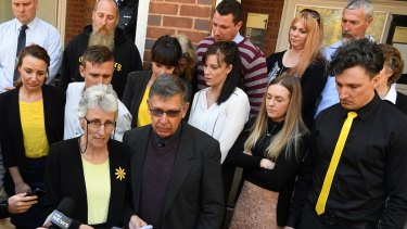 Stephanie Scott's mother Merrilyn addresses the media outside court, joined by family and friends, including Stephanie's father, Bob, and her fiance Aaron Leeson-Woolley (in the striped jersey).