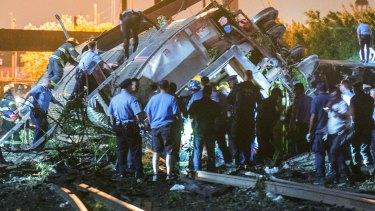 Emergency responders search for passenger in the wreckage.