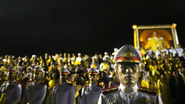 Thai military stand guard during celebrations to pay respect to Thailand's King Bhumibol Adulyadej on his birthday in 2012.