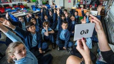 Preschoolers learning to read.