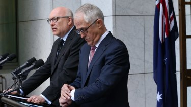 Prime Minister Malcolm Turnbull stood with Attorney-General George Brandis as he made the High Court announcements.