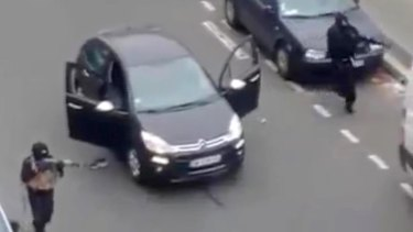 Gunmen outside the Paris offices of Charlie Hebdo.