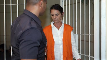 Sara Connor is escorted to the courtroom by a guard in March.
