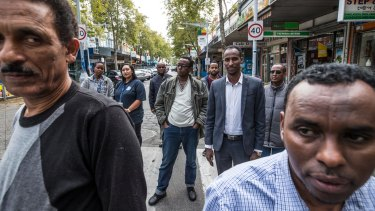 Traders and Dr Berhan Ahmed (far left) say drug users are scaring customers away from the Little Africa precinct.