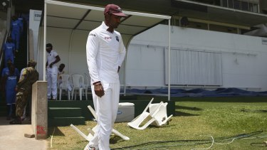 Woeful Windies: A forlorn West Indies captain Denesh Ramdin emerges from the pavilion after his team was comprehensively beaten in the second Test in Jamaica.