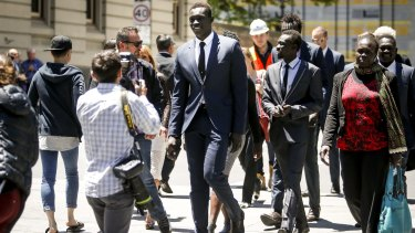 Majak Daw outside the County Court