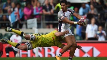 Unstoppable: Maka Unufe of USA is tackled by Nick Malouf of Australia in the final of the London Sevens.