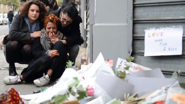 A woman cries near Le Petit Cambodge restaurant in Paris after the deadly attacks. But how much will this latest atrocity turn public opinion?