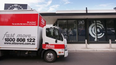 A moving van is seen parked outside the Carlton headquarters.