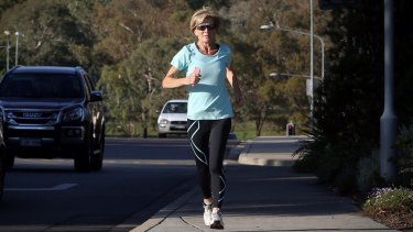 Foreign Affairs Minister Julie Bishop runs to Parliament House in Canberra on Wednesday.