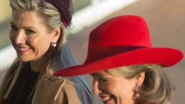 Netherlands' Queen Maxima, left, and Belgian Queen Mathilde arrive at the Cobra Museum in Amstelveen, near Amsterdam on Tuesday.