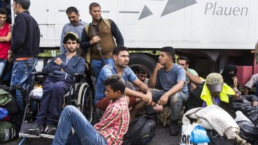 Refugees wait in Horgos on the Serbian side of the Hungarian border hoping for the crossing to reopen.