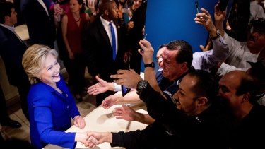 Democratic presidential candidate Hillary Clinton greets employees at the Mirage in Las Vegas on Wednesday.