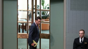 Liberal MP Andrew Laming leaves after being named by Speaker Bronwyn Bishop ahead of Question Time at Parliament House in Canberra on Wednesday.